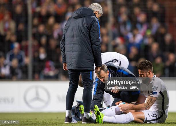 Olivier Giroud of France gets medical attention during the FIFA 2018 World Cup Qualifier between Luxembourg and France at Stade Josy Barthel on March...