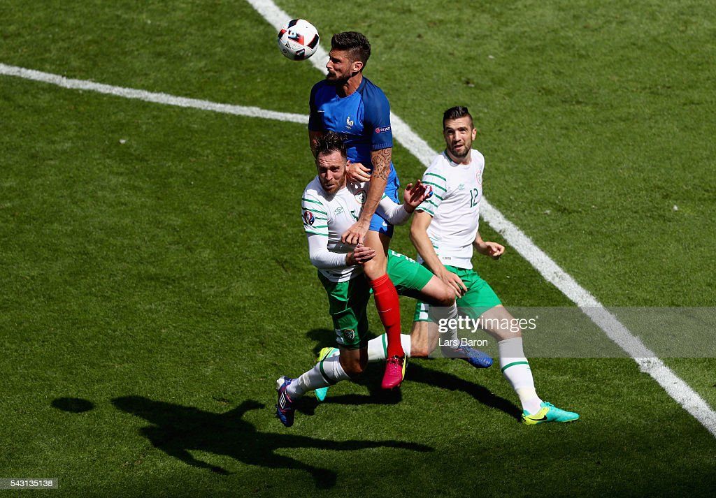 Olivier Giroud of France heads down the ball to set up France's second goal by Antoine Griezmann during the UEFA EURO 2016 round of 16 match between France and Republic of Ireland at Stade des Lumieres on June 26, 2016 in Lyon, France.