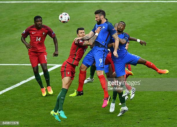 Olivier Giroud of France heads the ball during the UEFA EURO 2016 Final match between Portugal and France at Stade de France on July 10 2016 in Paris...