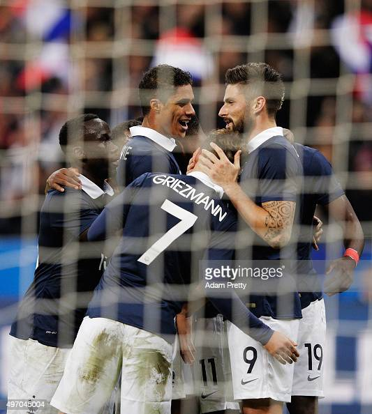 Olivier Giroud of France is congratulated after scroing the first goal during the International Friendly match between France and Germany at the...