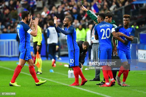 Olivier Giroud of France is replaced by Alexandre Lacazette of France and Anthony Martial of France replaces Kingsley Coman of France during the...