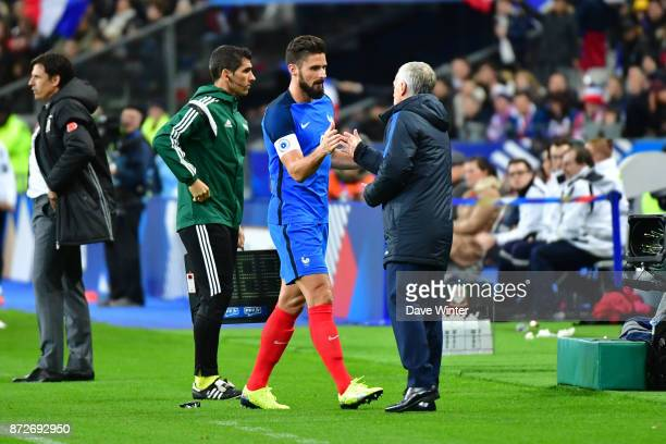 Olivier Giroud of France is substituted by France coach Didier Deschamps during the international friendly match between France and Wales at Stade de...