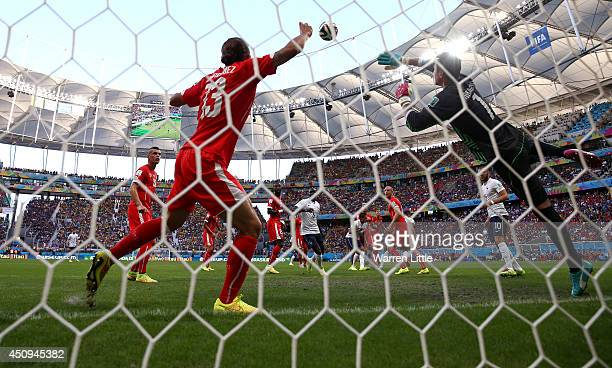 Olivier Giroud of France scores his team's first goal on a header past goalkeeper Diego Benaglio of Switzerland during the 2014 FIFA World Cup Brazil...