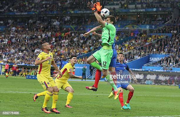 Olivier Giroud of France scores the opening goal during the UEFA EURO 2016 Group A match between France and Romania at Stade de France on June 10...