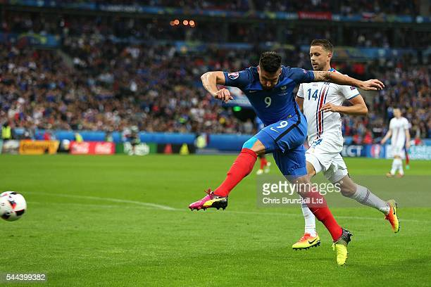 Olivier Giroud of France scores the opening goal during the UEFA Euro 2016 Quarter Final match between France and Iceland at Stade de France on July...