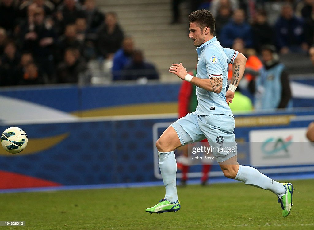 <a gi-track='captionPersonalityLinkClicked' href=/galleries/search?phrase=Olivier+Giroud&family=editorial&specificpeople=5678034 ng-click='$event.stopPropagation()'>Olivier Giroud</a> of France scores the opening goal of the FIFA 2014 World Cup qualifier match between France and Georgia at the Stade de France on March 22, 2013 in Saint-Denis near Paris, France.