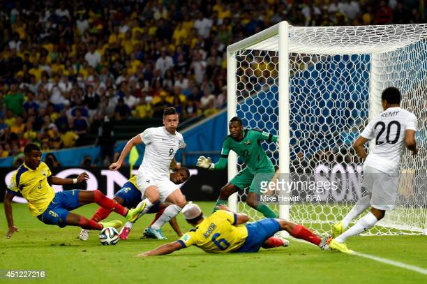 Olivier Giroud of France tries to shoot the ball from Loic Remy during the 2014 FIFA World Cup Brazil Group E match between Ecuador and France at...