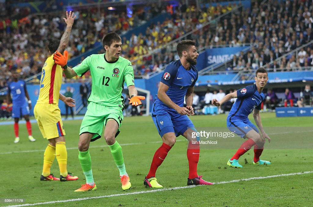 Olivier Giroud of France watches his header go into the net to open the scoring during the UEFA EURO 2016 Group A match between France and Romania at Stade de France on June 10, 2016 in Paris, France.