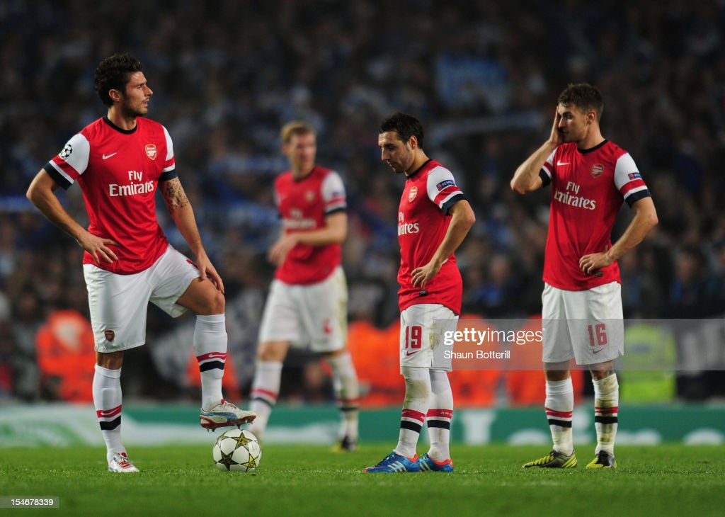 <a gi-track='captionPersonalityLinkClicked' href=/galleries/search?phrase=Olivier+Giroud&family=editorial&specificpeople=5678034 ng-click='$event.stopPropagation()'>Olivier Giroud</a>, <a gi-track='captionPersonalityLinkClicked' href=/galleries/search?phrase=Santi+Cazorla&family=editorial&specificpeople=709830 ng-click='$event.stopPropagation()'>Santi Cazorla</a> and <a gi-track='captionPersonalityLinkClicked' href=/galleries/search?phrase=Aaron+Ramsey+-+Soccer+Player&family=editorial&specificpeople=4784114 ng-click='$event.stopPropagation()'>Aaron Ramsey</a> of Arsenal look dejected during the UEFA Champions League Group B match between Arsenal and FC Schalke at the Emirates Stadium on October 24, 2012 in London, England.