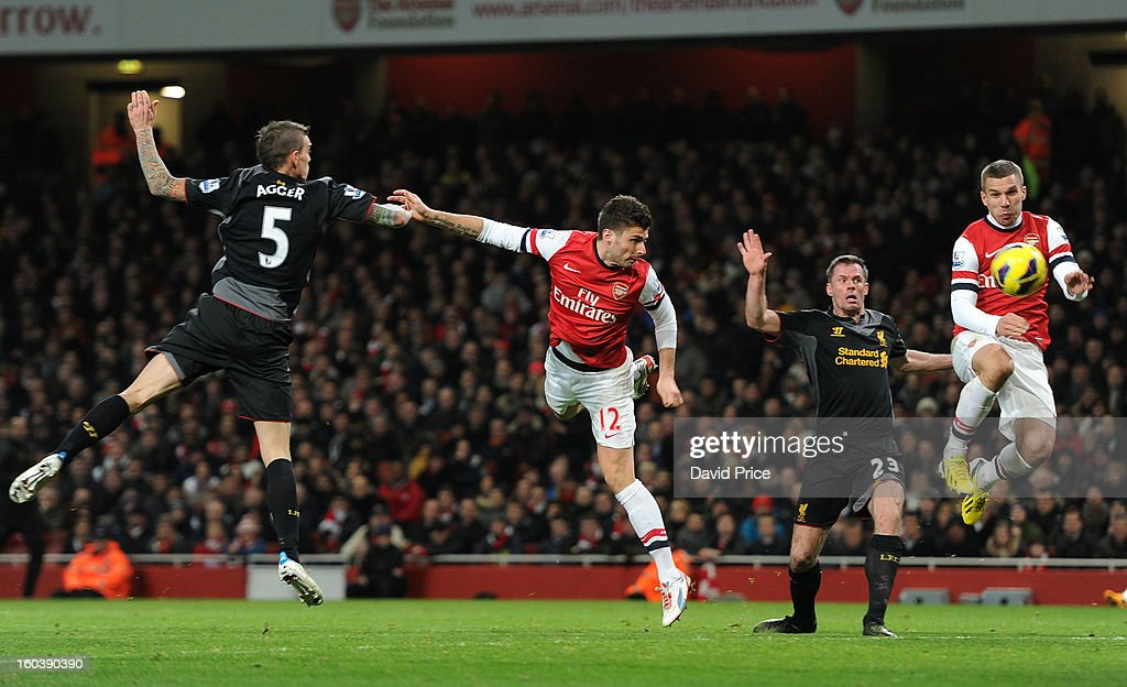 Olivier Giroud scores Arsenal's 1st goal as he gets between Daniel Agger and Jamie Carragher of Liverpool as Lukas Podolski of Arsenal closes in during the Barclays Premier League match between Arsenal and Liverpool at Emirates Stadium on January 30, 2013 in London, England.