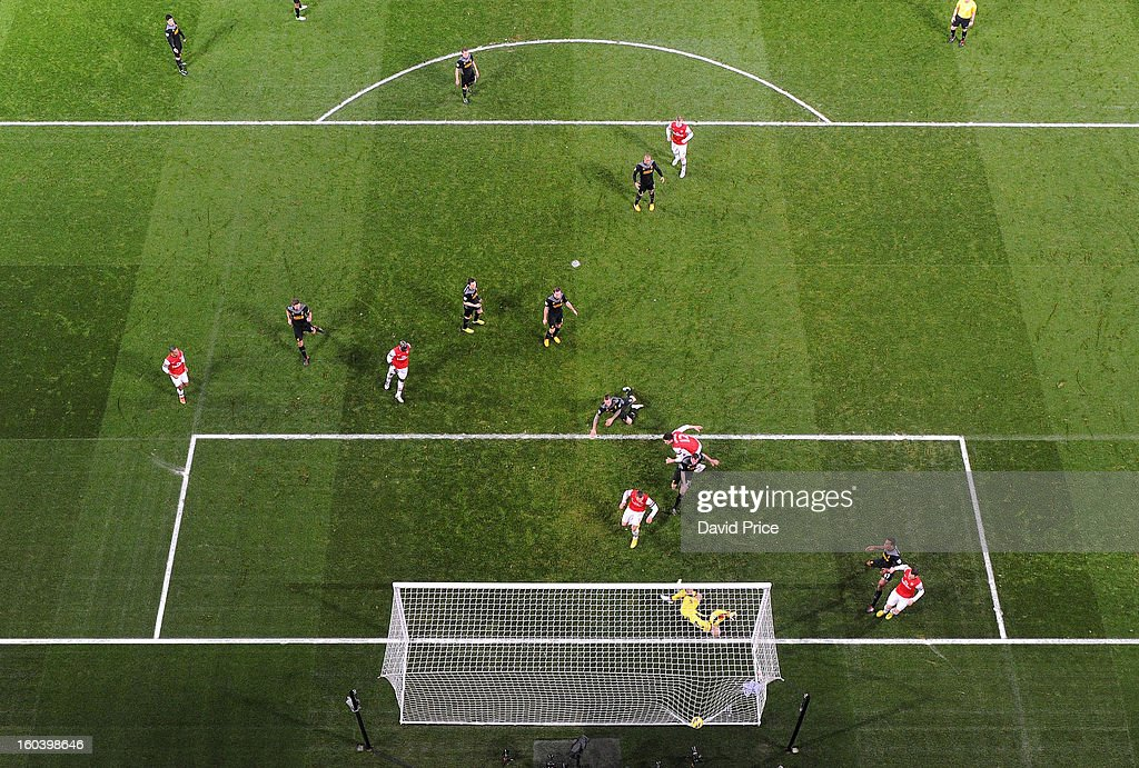 Olivier Giroud scores Arsenal's 1st goal past Pepe Reina of Liverpool during the Barclays Premier League match between Arsenal and Liverpool at Emirates Stadium on January 30, 2013 in London, England.