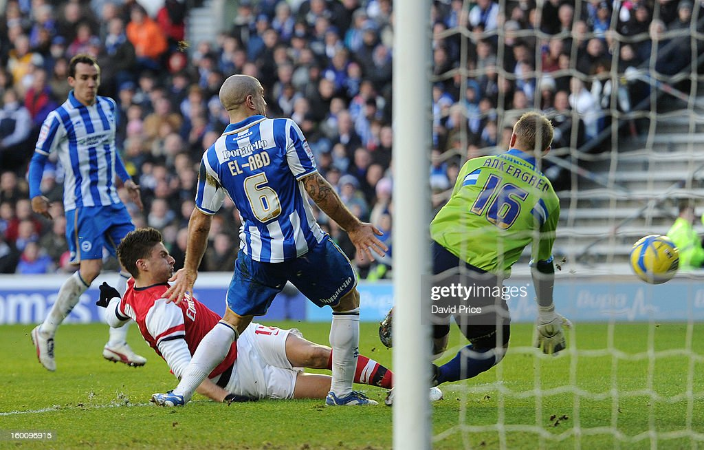 Olivier Giroud scores Arsenal's and his 2nd goal past Casper Ankergren as Adam El-Abd of Brighton closes in during the FA Cup Fourth Round match between Brighton & Hove Albion and Arsenal at the Amex Stadium on January 26, 2013 in Brighton, England.