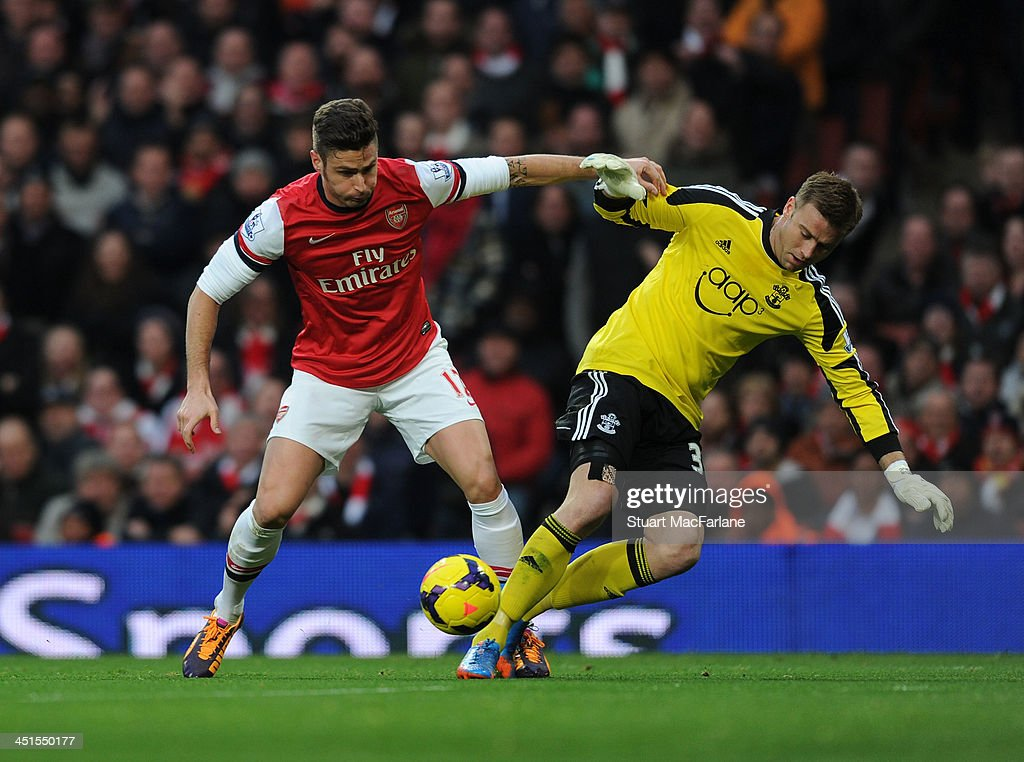 <a gi-track='captionPersonalityLinkClicked' href=/galleries/search?phrase=Olivier+Giroud&family=editorial&specificpeople=5678034 ng-click='$event.stopPropagation()'>Olivier Giroud</a> tackles Southampton goalkeeper <a gi-track='captionPersonalityLinkClicked' href=/galleries/search?phrase=Artur+Boruc&family=editorial&specificpeople=554761 ng-click='$event.stopPropagation()'>Artur Boruc</a> to score for Arsenal during the match at Emirates Stadium on November 23, 2013 in London, England.