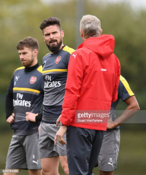 Olivier Giroud talks to Arsenal manager Arsene Wenger during a training session at London Colney on April 29 2017 in St Albans England