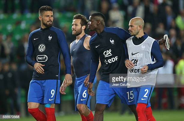 Olivier Giroud Yohan Cabaye Paul Pogba Christophe Jallet of France look on following the international friendly match between France and Cameroon at...