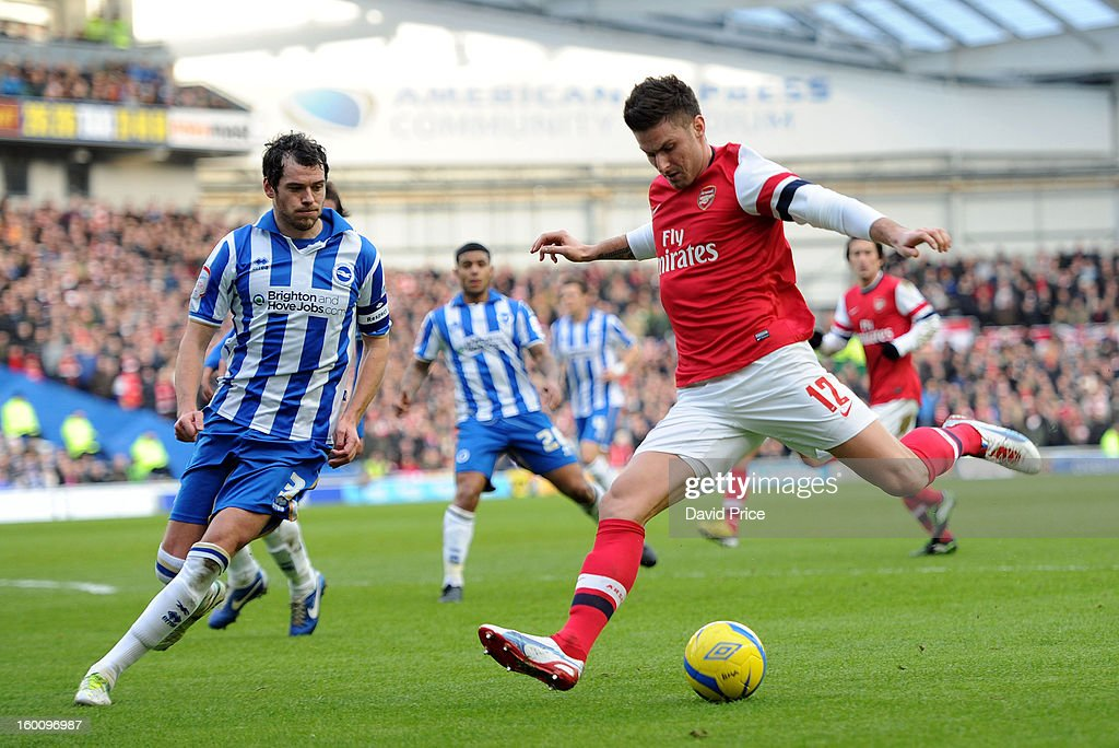 Olivier Grioud of Arsenal shoots as gordon Greer of Brighton closes in during the FA Cup Fourth Round match between Brighton & Hove Albion and Arsenal at the Amex Stadium on January 26, 2013 in Brighton, England.