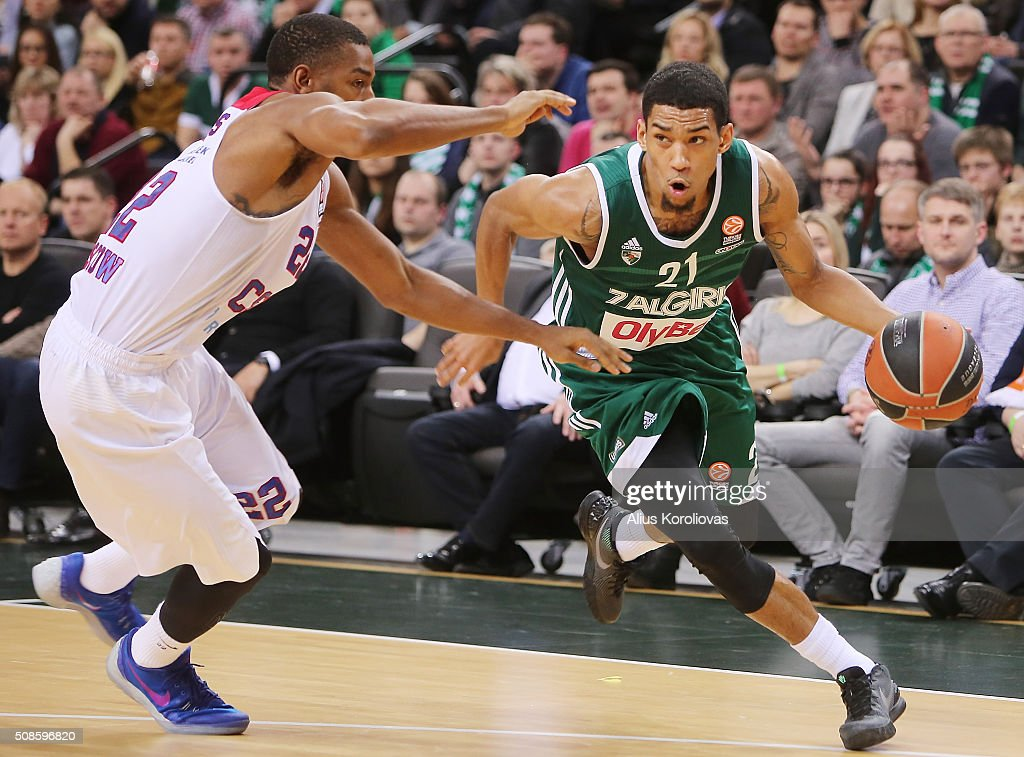 <a gi-track='captionPersonalityLinkClicked' href=/galleries/search?phrase=Olivier+Hanlan&family=editorial&specificpeople=10135196 ng-click='$event.stopPropagation()'>Olivier Hanlan</a>, #21 of Zalgiris Kaunas competes with <a gi-track='captionPersonalityLinkClicked' href=/galleries/search?phrase=Cory+Higgins&family=editorial&specificpeople=4950721 ng-click='$event.stopPropagation()'>Cory Higgins</a>, #22 of CSKA Moscow in action during the Turkish Airlines Euroleague Basketball Top 16 Round 6 game between Zalgiris Kaunas v CSKA Moscow at Zalgirio Arena on February 5, 2016 in Kaunas, Lithuania.