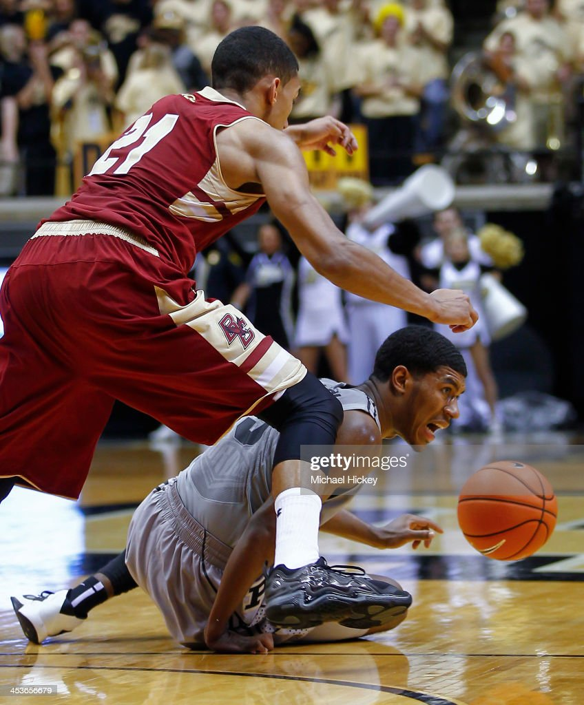 Olivier Hanlan #21 of the Boston College Eagles and Ronnie Johnson #3 of the Purdue Boilermakers battle for a loose ball at Mackey Arena on December 4, 2013 in West Lafayette, Indiana. Purdue defeated Boston College 88-67.