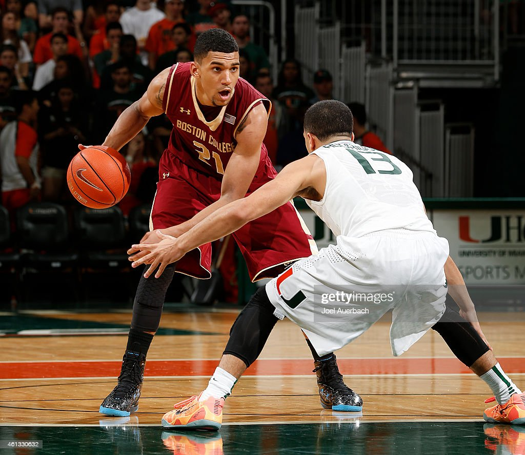 <a gi-track='captionPersonalityLinkClicked' href=/galleries/search?phrase=Olivier+Hanlan&family=editorial&specificpeople=10135196 ng-click='$event.stopPropagation()'>Olivier Hanlan</a> #21 of the Boston College Eagles brings the ball through center court against <a gi-track='captionPersonalityLinkClicked' href=/galleries/search?phrase=Angel+Rodriguez+-+Jugador+de+baloncesto&family=editorial&specificpeople=10584461 ng-click='$event.stopPropagation()'>Angel Rodriguez</a> #13 of the Miami Hurricanes during second half action on January 10, 2015 at the BankUnited Center in Coral Gables, Florida. Miami defeated Boston College 60-56.