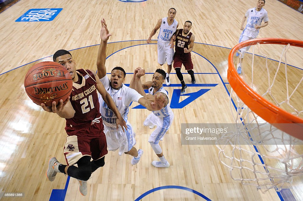 <a gi-track='captionPersonalityLinkClicked' href=/galleries/search?phrase=Olivier+Hanlan&family=editorial&specificpeople=10135196 ng-click='$event.stopPropagation()'>Olivier Hanlan</a> #21 of the Boston College Eagles drives past Nate Britt #0 of the North Carolina Tar Heels during a second round game of the ACC basketball tournament at Greensboro Coliseum on March 11, 2015 in Greensboro, North Carolina.