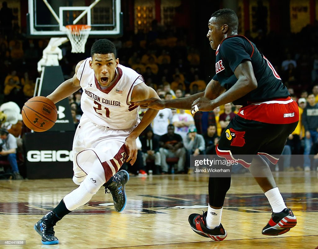 <a gi-track='captionPersonalityLinkClicked' href=/galleries/search?phrase=Olivier+Hanlan&family=editorial&specificpeople=10135196 ng-click='$event.stopPropagation()'>Olivier Hanlan</a> #21 of the Boston College Eagles drives to the basket past <a gi-track='captionPersonalityLinkClicked' href=/galleries/search?phrase=Terry+Rozier&family=editorial&specificpeople=11540564 ng-click='$event.stopPropagation()'>Terry Rozier</a> #0 of the Louisville Cardinals in the second half during the game at Conte Forum on January 28, 2015 in Chestnut Hill, Massachusetts.