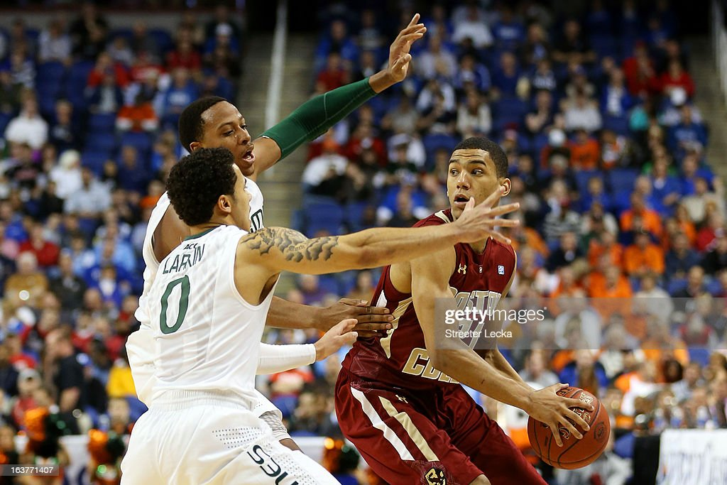 Olivier Hanlan #21 of the Boston College Eagles handles the ball against Shane Larkin #0 and Steve Sorenson #3 of the Miami Hurricanes during the quarterfinals of the ACC Men's Basketball Tournament at the Greensboro Coliseum on March 15, 2013 in Greensboro, North Carolina.