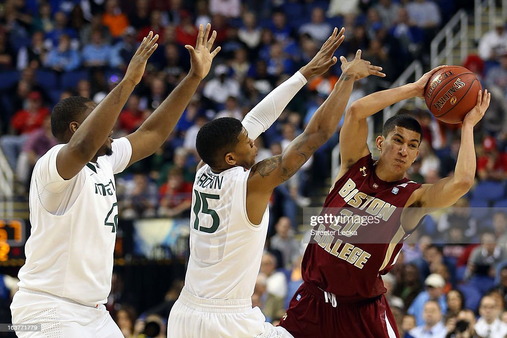 Olivier Hanlan #21 of the Boston College Eagles handles the ball against Reggie Johnson #42 and Rion Brown #15 of the Miami Hurricanes during the quarterfinals of the ACC Men's Basketball Tournament at the Greensboro Coliseum on March 15, 2013 in Greensboro, North Carolina.
