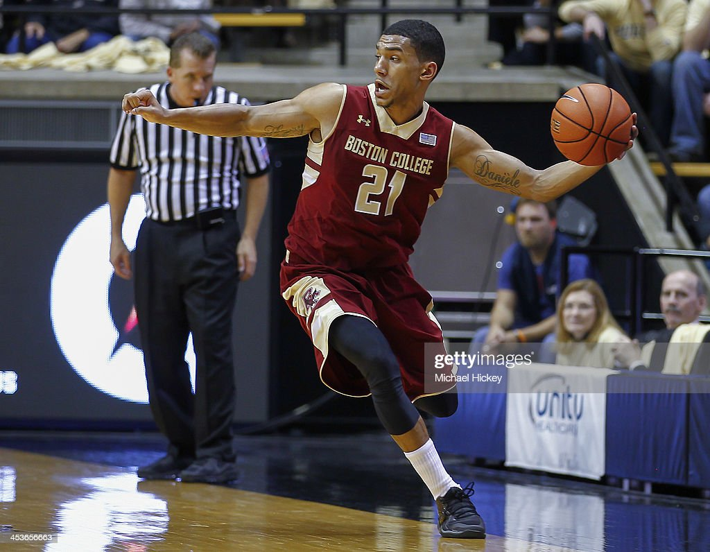 Olivier Hanlan #21 of the Boston College Eagles saves the ball from going out of bounds during the game against the Purdue Boilermakers at Mackey Arena on December 4, 2013 in West Lafayette, Indiana. Purdue defeated Boston College 88-67.