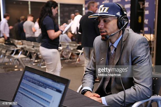 Olivier Hanlan of the Utah Jazz talks with the local radio broadcast after the press conference the day after the 2015 Draft at Zions Basketball...