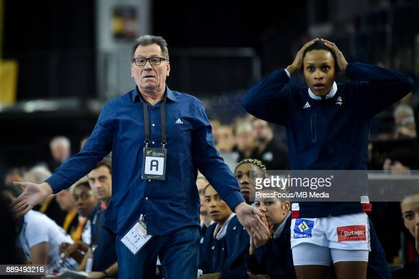Olivier Krumbholz head coach of team France and Allison Pineau of France react to referee decision during IHF Women's Handball World Championship...