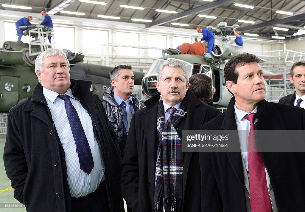 Olivier Lambert (L) and Joseph Saporito (R) Eurocopter vice-Presidents and Jan Pietowski (C), President of the Military Aviation Factory No1 in Lodz visit the factory after signing an agreement on April 4, 2013. Eurocopter, the largest helicopter manufacturer in the world, signed a contract with the Military Aviation Factory No1 in Lodz. The agreement is an order for 70 helicopters for the Polish Army.
