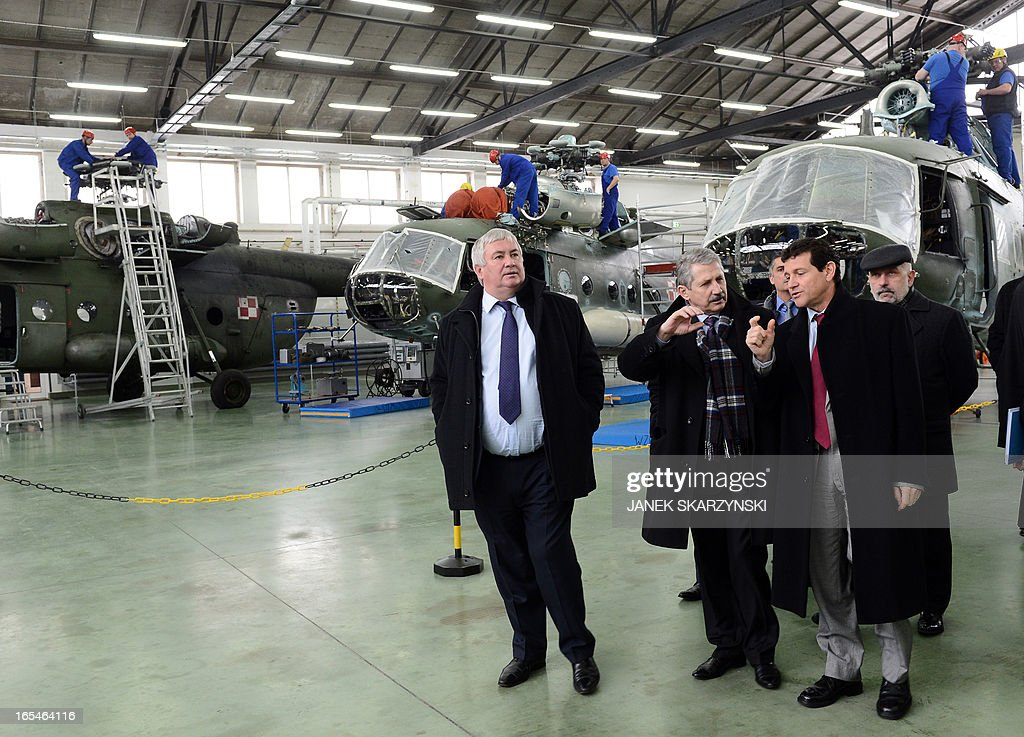 Olivier Lambert (L) and Joseph Saporito (2nd R) Eurocopter vice-Presidents and Jan Pietowski (C), President of the Military Aviation Factory No1 in Lodz visit the factory after signing an agreement on April 4, 2013. Eurocopter, the largest helicopter manufacturer in the world, signed a contract with the Military Aviation Factory No1 in Lodz. The agreement is an order for 70 helicopters for the Polish Army.