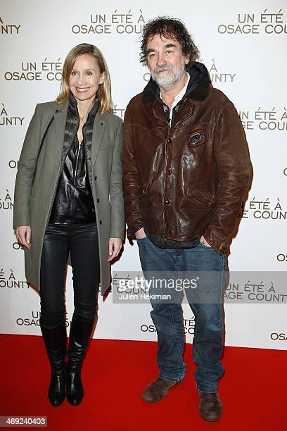 Olivier Marchal and his wife Catherine attend the 'August Osage County' Paris premiere at Cinema UGC Normandie on February 13 2014 in Paris France