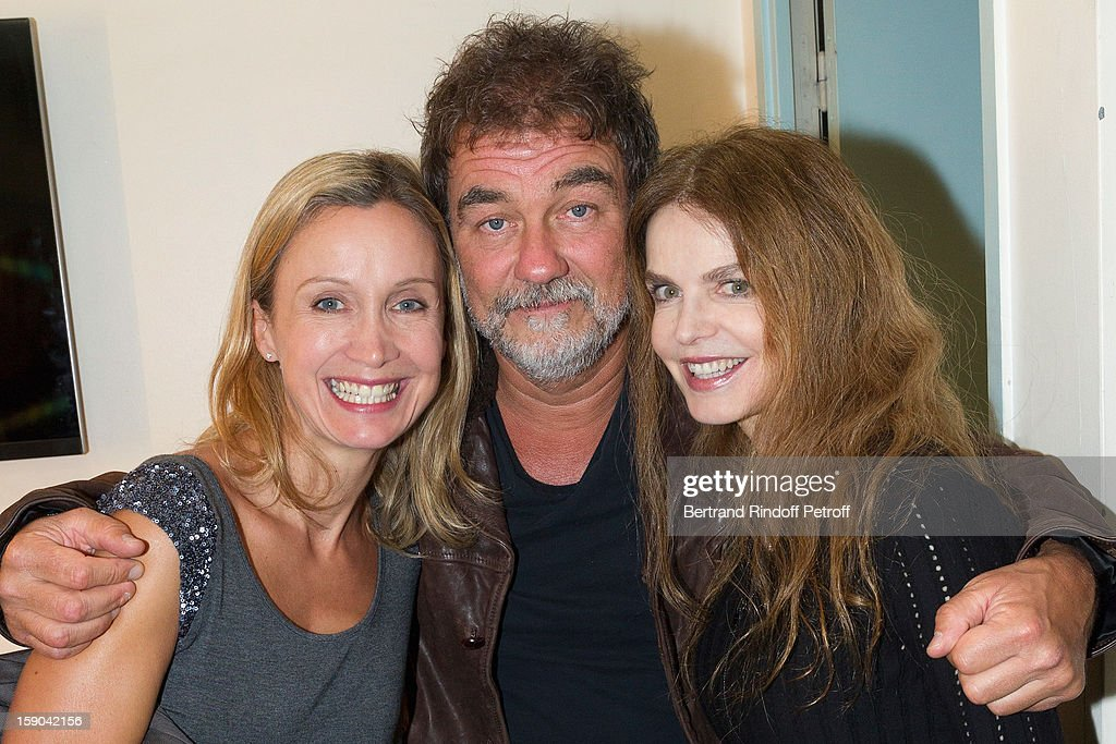 Olivier Marchal (C) poses with his wife Catherine (L) and Cyrielle Clair after attending the show of French impersonator Laurent Gerra at Olympia hall on January 4, 2013 in Paris, France.