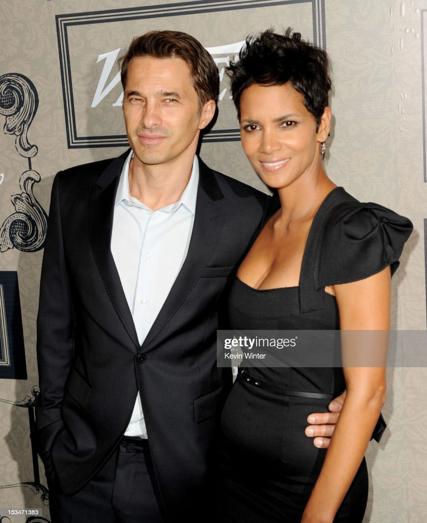 <a gi-track='captionPersonalityLinkClicked' href=/galleries/search?phrase=Olivier+Martinez&family=editorial&specificpeople=213013 ng-click='$event.stopPropagation()'>Olivier Martinez</a> (L) and actress <a gi-track='captionPersonalityLinkClicked' href=/galleries/search?phrase=Halle+Berry&family=editorial&specificpeople=201726 ng-click='$event.stopPropagation()'>Halle Berry</a> arrives at Variety's Power of Women presented by Lifetime at the Beverly Wilshire Hotel on October 5, 2012 in Beverly Hills, California.