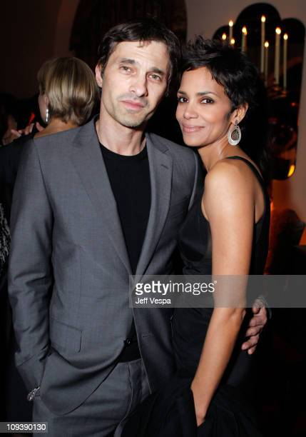 Olivier Martinez and actress Halle Berry attend Harvey Weinstein and Dior's Oscar Dinner at Chateau Marmont on February 23 2011 in Los Angeles...