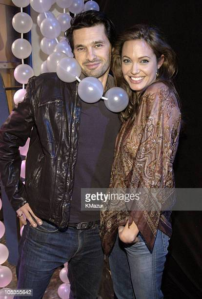 Olivier Martinez and Angelina Jolie during Ben Affleck Liv Tyler and Angelina Jolie Visit MTV's 'TRL' March 8 2004 at MTV Studios Times Square in New...