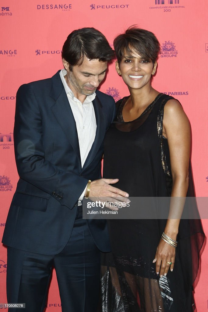 Olivier Martinez and Halle Berry attend the 'Toiles Enchantees' Red Carpet As Part of The Champs Elysees Film Festival 2013 at Publicis Champs Elysees on June 13, 2013 in Paris, France .