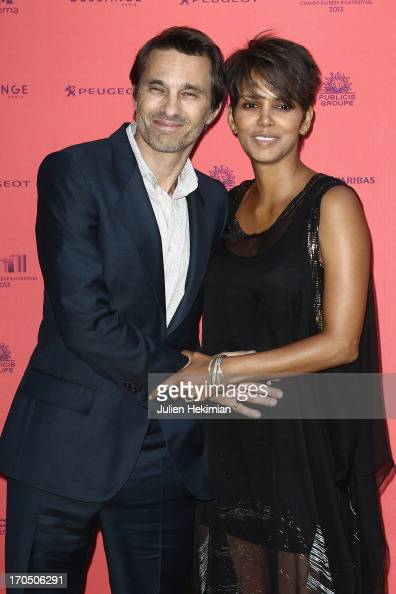 Olivier Martinez and Halle Berry attend the 'Toiles Enchantees' Red Carpet As Part of The Champs Elysees Film Festival 2013 at Publicis Champs...