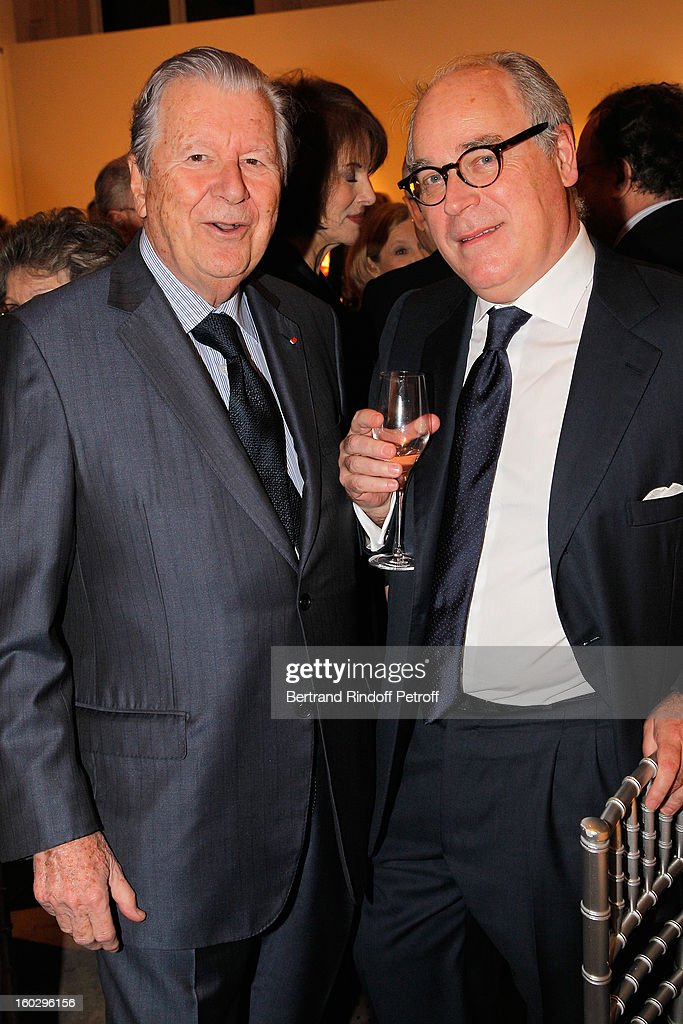 Olivier Merveilleux du Vignaux (R) and Bruno Roger attend a dinner in honor of Helene David-Weill, who presided through 1994 - 2012 Les Arts Decoratifs, one of the largest decorative arts museums in the world, at Sotheby's on January 28, 2013 in Paris, France.