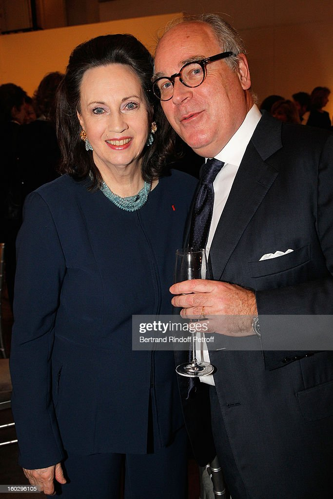 Olivier Merveilleux du Vignaux (R) and Madame Claude Janssen attend a dinner in honor of Helene David-Weill, who presided through 1994 - 2012 Les Arts Decoratifs, one of the largest decorative arts museums in the world, at Sotheby's on January 28, 2013 in Paris, France.