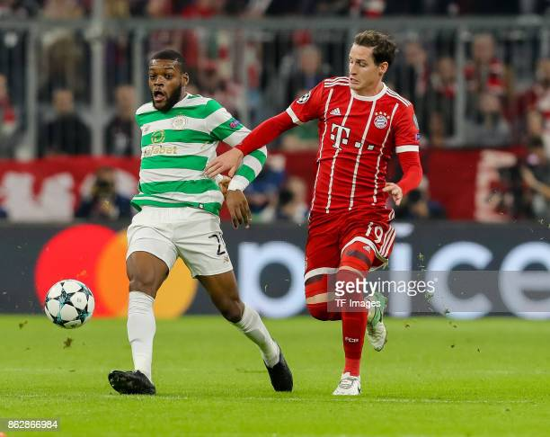 Olivier Ntcham of Celtic and Sebastian Rudy of Bayern Muenchen battle for the ball during the UEFA Champions League group B match between Bayern...
