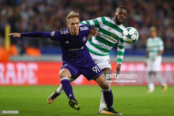 Olivier Ntcham of Celtic closes down Lukasz Teodorczyk of RSC Anderlecht during the UEFA Champions League group B match between RSC Anderlecht and...