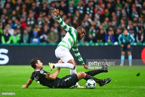 Olivier Ntcham of Celtic is tackled by Thiago Motta of PSG during the Uefa Champions League match between Glasgow Celtic and Paris Saint Germain at...