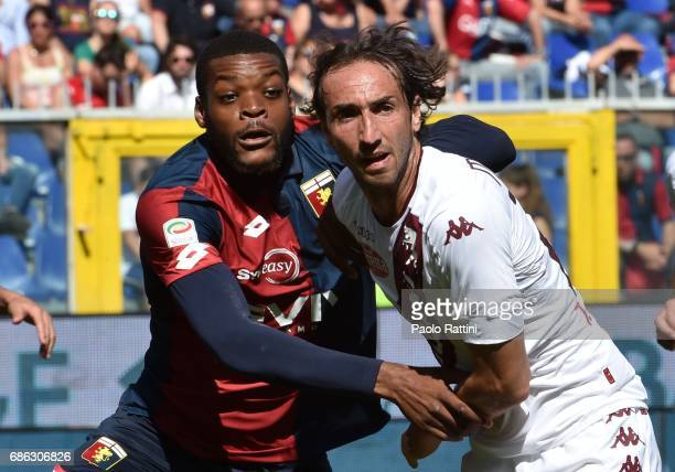 Olivier Ntcham of Genoa and Emiliano Moretti of Torino during the Serie A match between Genoa CFC and FC Torino at Stadio Luigi Ferraris on May 21...