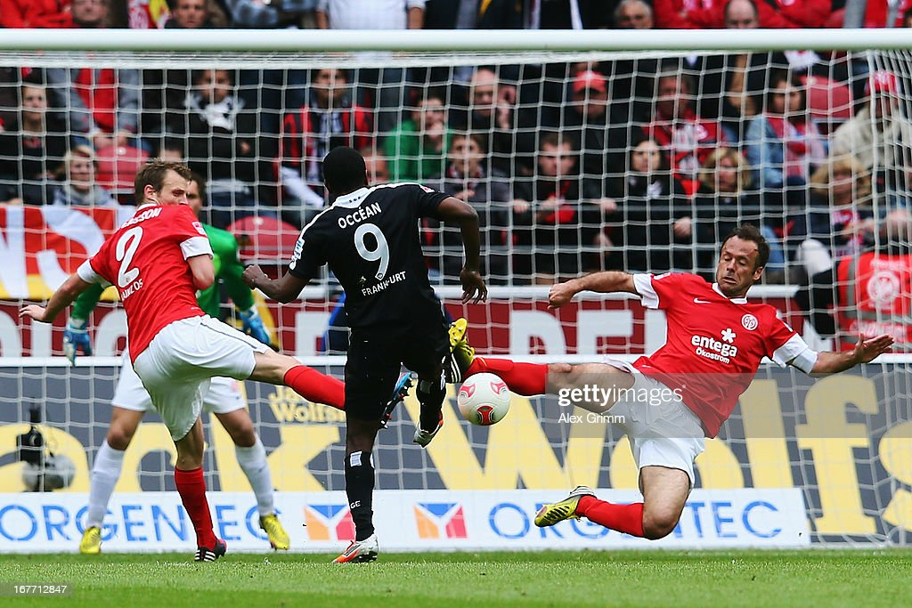 Olivier Occean (C) of Frankfurt tries to score against Bo Svensson (L) and Nikolce Noveski of Mainz during the Bundesliga match between 1. FSV Mainz 05 and Eintracht Frankfurt at Coface Arena on April 28, 2013 in Mainz, Germany.