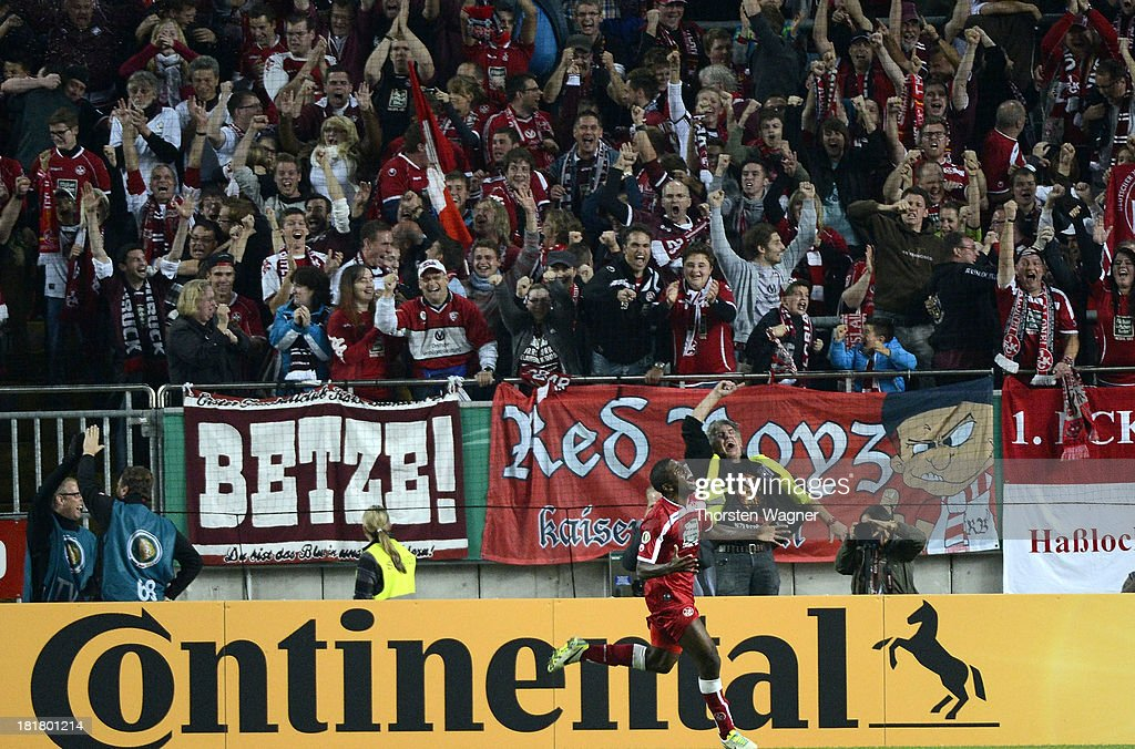 Olivier Occean of Kaiserslautern celebrates after scoring his teams third goal during the DFB Cup 2nd round match between 1.FC Kaiserslautern and Hertha BSC Berlin at Fritz-Walter-Stadion on September 25, 2013 in Kaiserslautern, Germany.