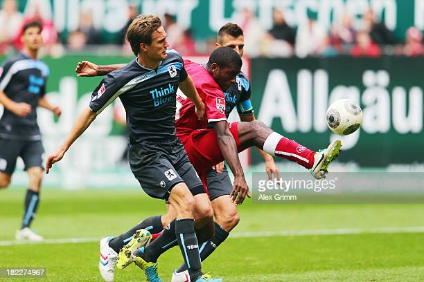 Olivier Occean of Kaiserslautern is challenged by Kai Buelow and Guillermo Vallori of Muenchen during the Second Bundesliga match between 1 FC...