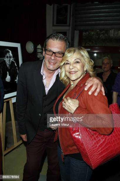 Olivier Palade and Nicoletta attend Photographer Olivier Palade Exhibition at La Chope des Puces on June 7 2017 in SaintOuen France