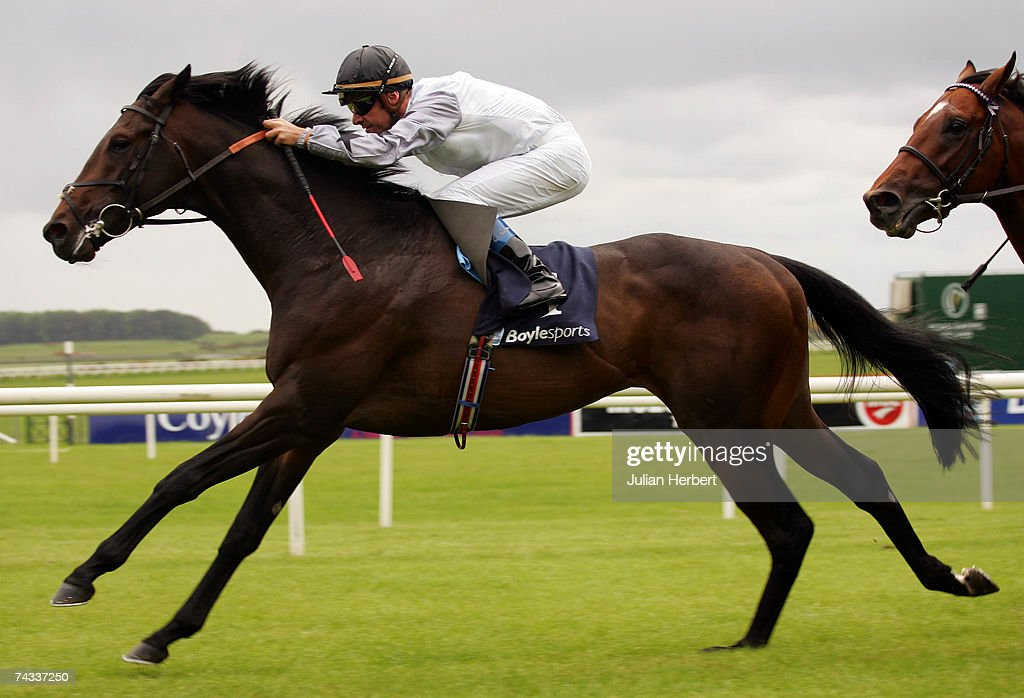 Olivier Peslier and Cockney Rebel lead the field home to land The Boylesports Irish 2000 Guineas Race run at The Curragh Racecourse on May 26 in The...